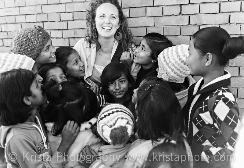 Krista Guenin with children of Lighthouse Nepal while working on a documentary about sex trafficking between Nepal and India