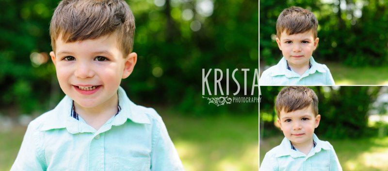 adorable toddler boy in green shirt standing among green trees during springtime mini portrait session in New England
