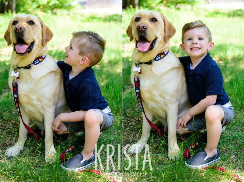 little boy in navy blue collared shirt running through green grass with his golden retriever on a leash during springtime mini portrait sessions in New England