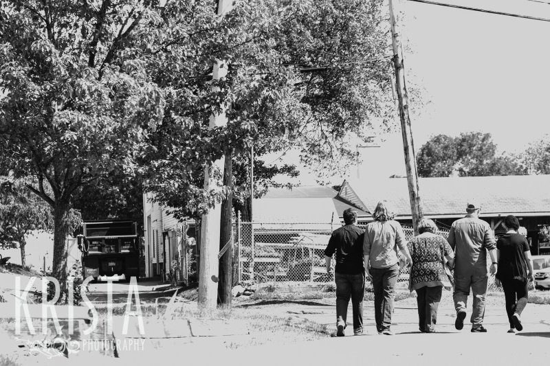 black and white image of family of five walking down the driveway following their springtime mini portrait session in New England