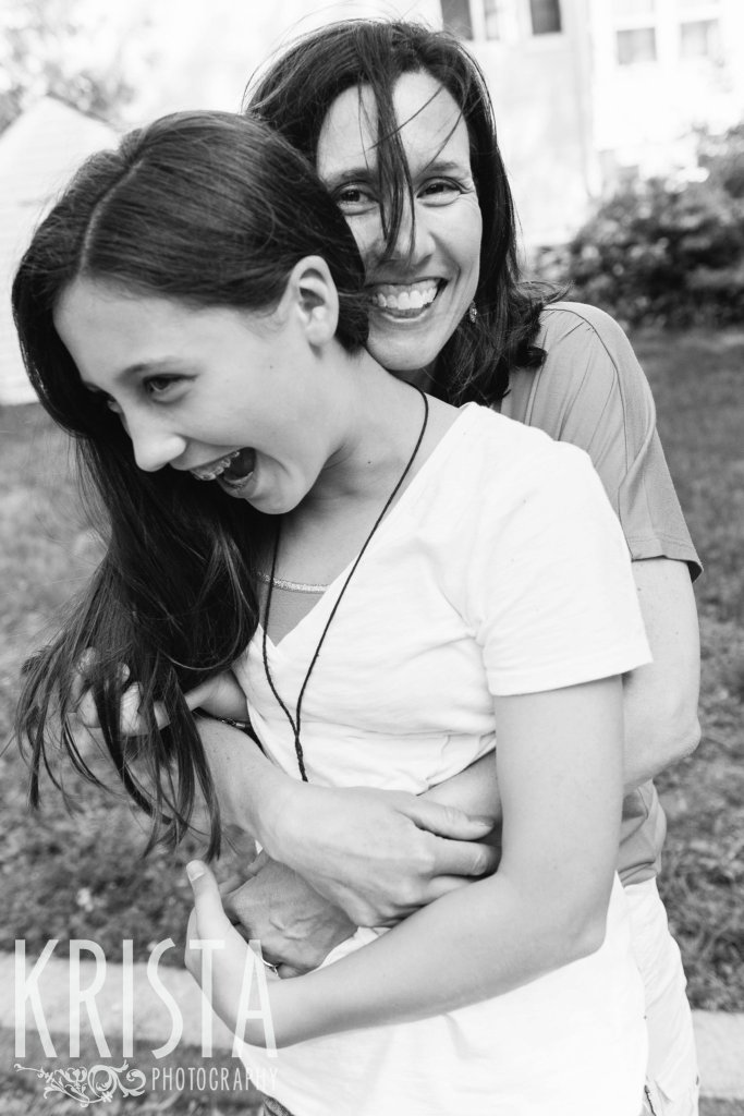 mother and teenage daughter laughing during spring mini portrait session