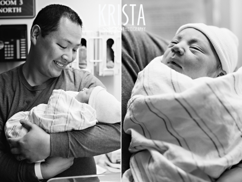 black and white image of new father proudly holding newborn baby boy in hospital soon after his birth