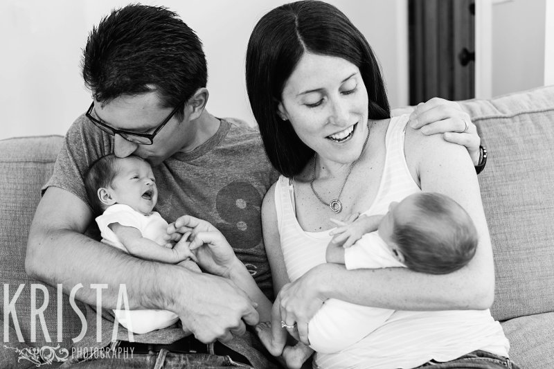black and white image of family with newborn baby boy girl twins at home