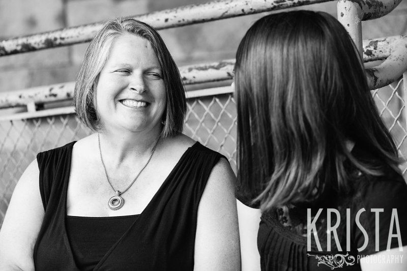 black and white image of mother and daughter talking during lifestyle family portrait session