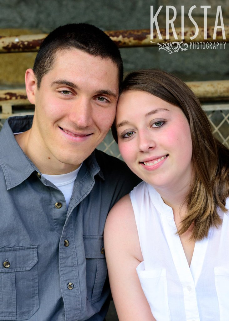 engaged couple during family portrait session near family home