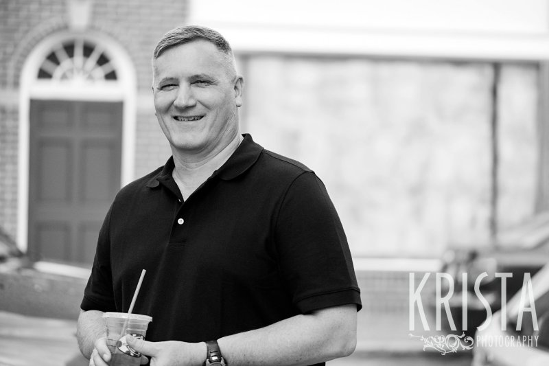 black and white image of father during lifestyle portrait session near family home in winchester, ma