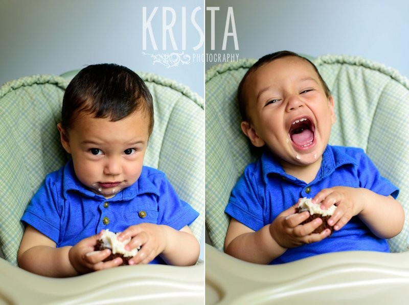 one year old baby boy in blue collared shirt trying cake on first birthday during lifestyle portrait session at home