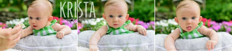 adorable three month old baby girl laying on belly on pillow in green gingham sundress outside in yard during lifestyle portrait session