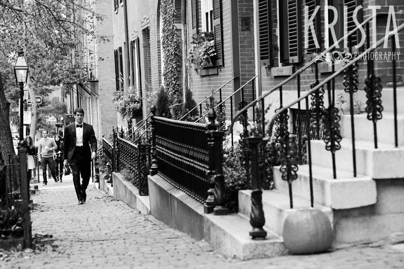 Groom walking down Chestnut Street. Getting Ready and Bride & Groom portraits on Beacon Hill, ceremony at Harvard Memorial Church, and reception at the Harvard Art Museums. Photo by Krista Photography, Boston Wedding Photographers