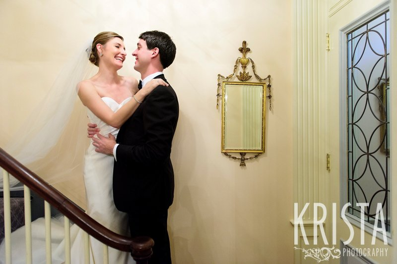 Totally natural First Look as Bride comes down the stairs to meet her Groom. Getting Ready and Bride & Groom portraits on Beacon Hill, ceremony at Harvard Memorial Church, and reception at the Harvard Art Museums. Photo by Krista Photography, Boston Wedding Photographers