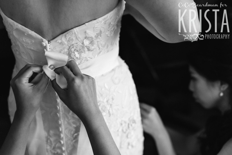 bride putting on her wedding dress © Krista Photography