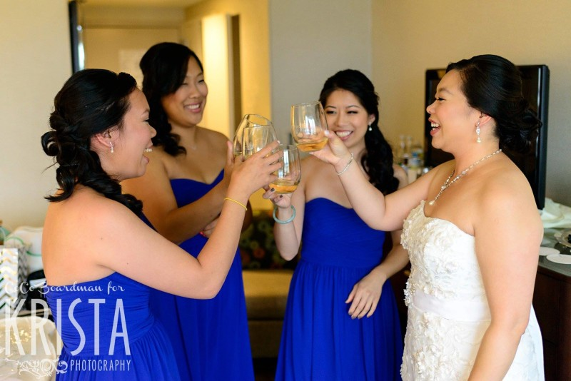 bride and her girls toasting before the wedding © Krista Photography