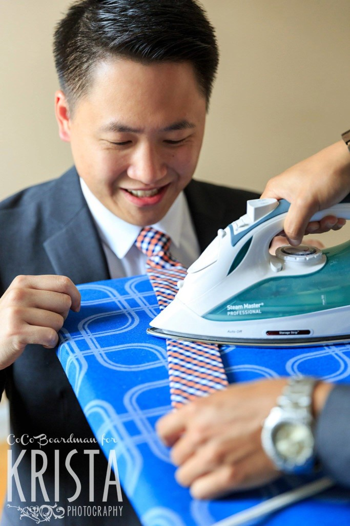 ironing the ties before the ceremony © Krista Photography