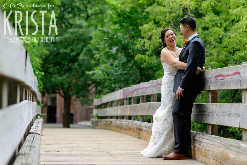 bride and groom on the bridge © Krista Photography