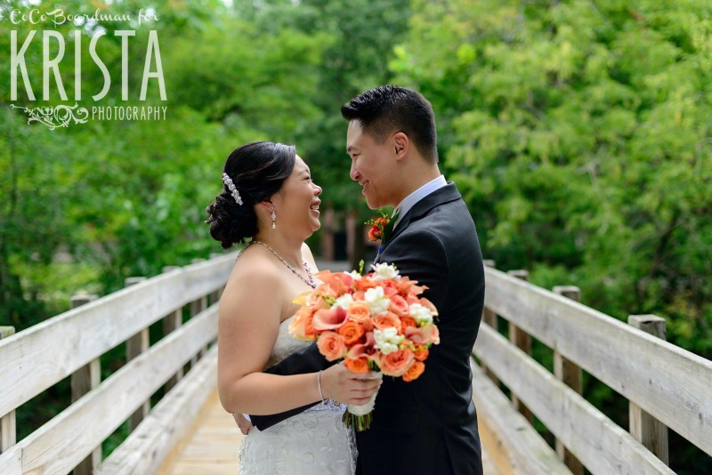 smiling bride and groom on bridge © Krista Photography