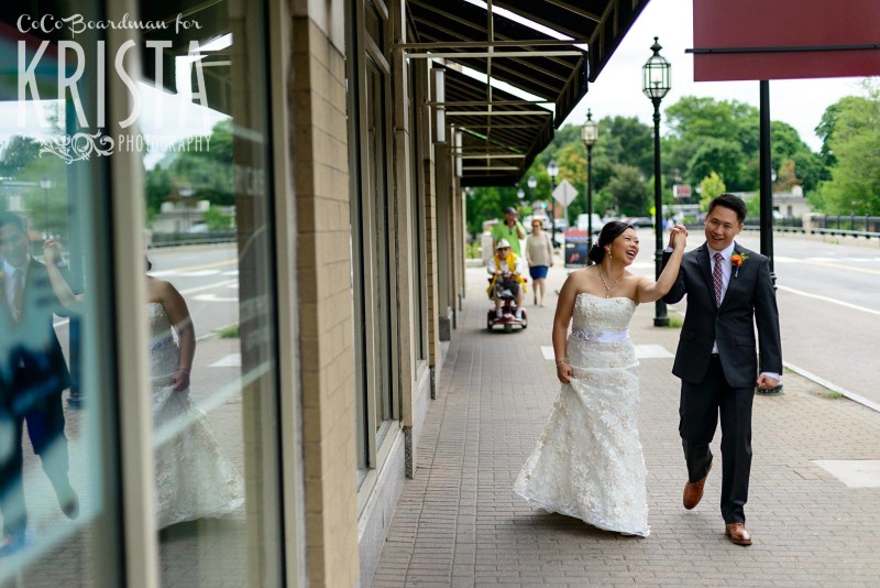 newlyweds walking through downtown © Krista Photography