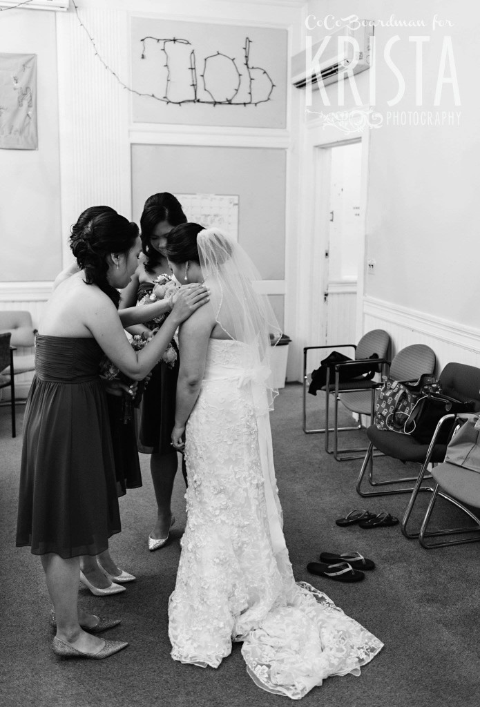 bridesmaids calming their bride © Krista Photography