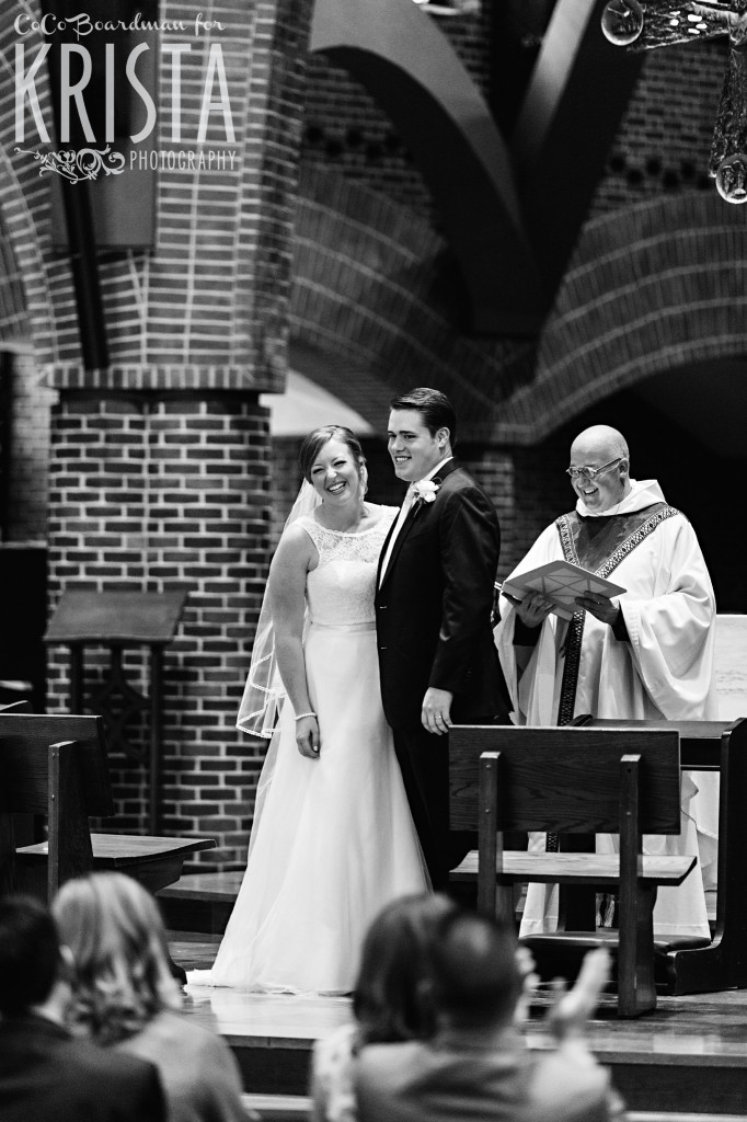 Bride and groom smiling away at the altar. © 2016 Krista Photography - www.kristaphoto.com