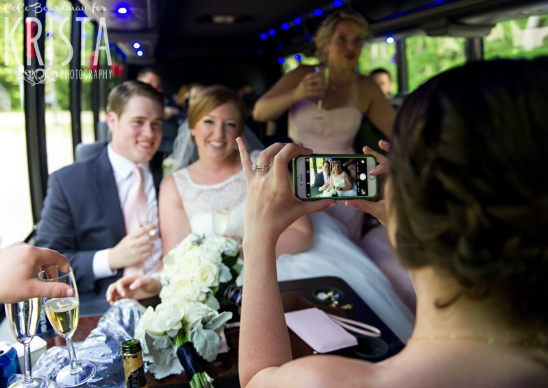 Catching the bride and groom on the party bus. © 2016 Krista Photography - www.kristaphoto.com