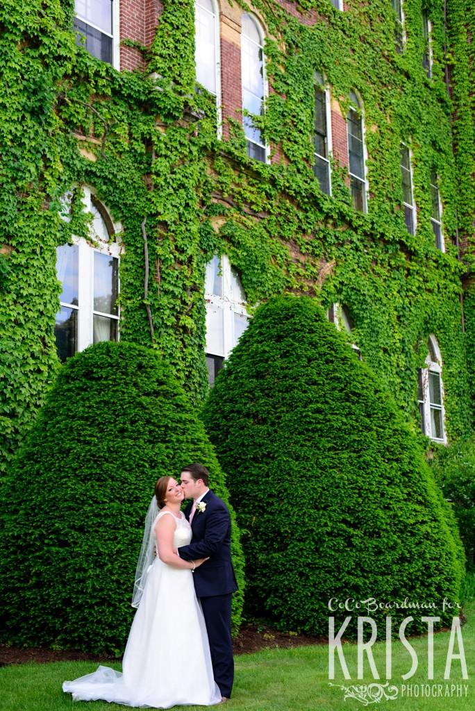 Bride and groom kissing under lush foliage. © 2016 Krista Photography - www.kristaphoto.com