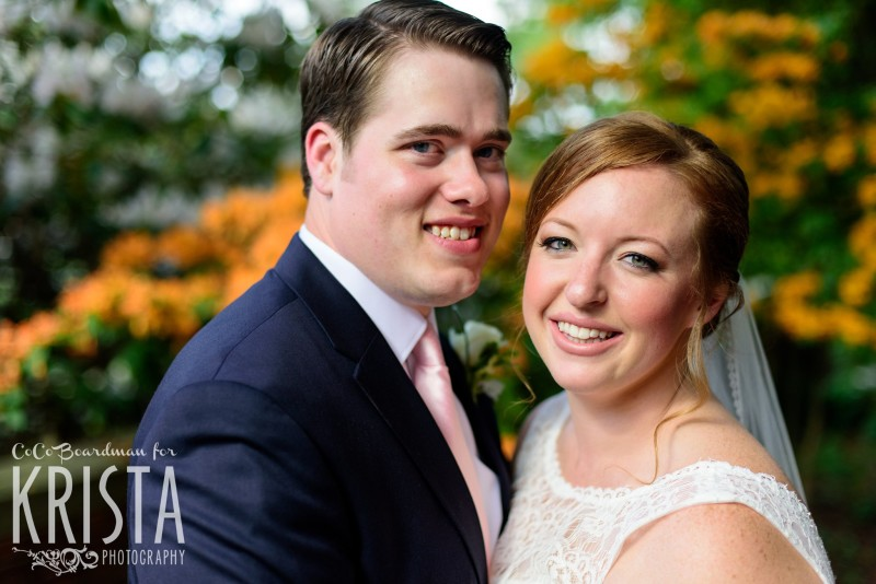 Smiling bride and groom at St. Anselm College. © 2016 Krista Photography - www.kristaphoto.com