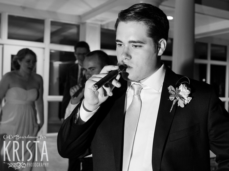 Groom and his guests smoking some cigars at the end of the night. © 2016 Krista Photography - www.kristaphoto.com