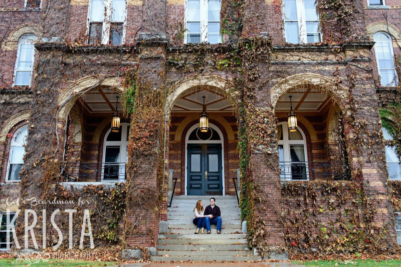 couple snuggling under viny archways of St. Anselm - Saint Anselm Engagement