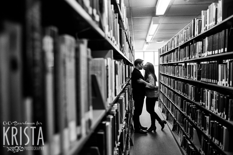 Hidden away and kissing in the library at St. Anselm College - Saint Anselm Engagement