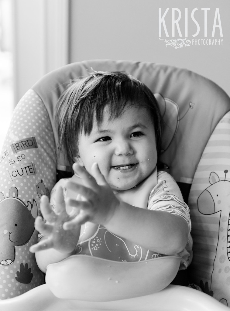 Clapping hands in high chair. 18-Month Portrait Session for family of 3 in Indianapolis, IN - © Krista Guenin | Krista Photography - www.kristaphoto.com