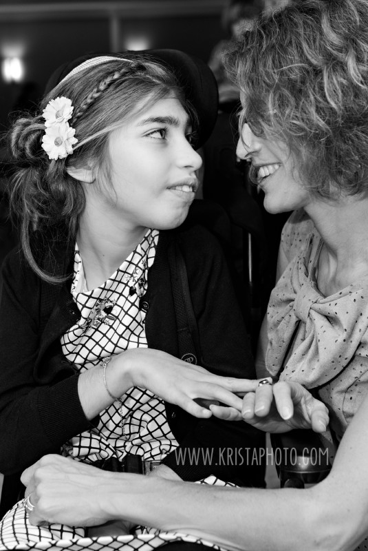 """I love this photo because it speaks volumes about the relationship between Cindy and her daughter, Mira.  In working with them, I was so touched by the way Cindy loves Mira, speaks to her, takes care of her, celebrates her, makes sure she knows she's special, not """"special"""" - it's absolutely beautiful.  So, we're celebrating Cindy, and all the mama's out there taking care of kids with special needs and extra challenges - your strength, patience, endurance, and love are inspiring!  #kristaphoto⠀#celebratingwomen #womenshistorymonth @kristaphoto"""